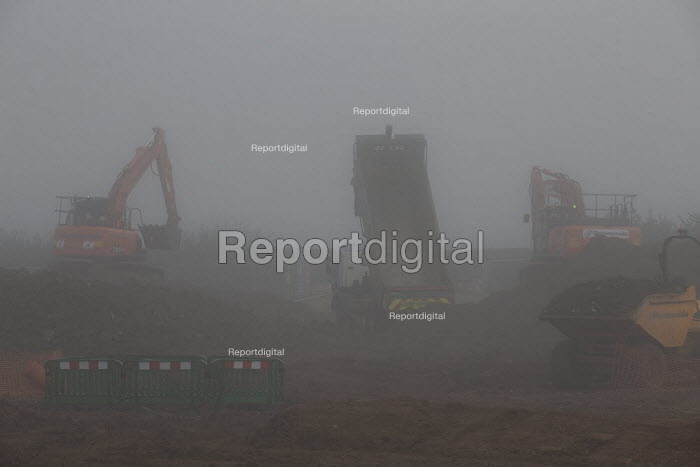 Construction of new housing, morning mist, Stratford upon Avon, Warwickshire. Spitfire Homes - John Harris - 2019-10-23