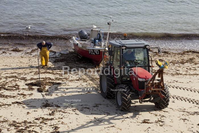 Sennen Cove, Cornwall, tractor pulling an inshore fishing boat ashore - David Mansell - 2015-07-18