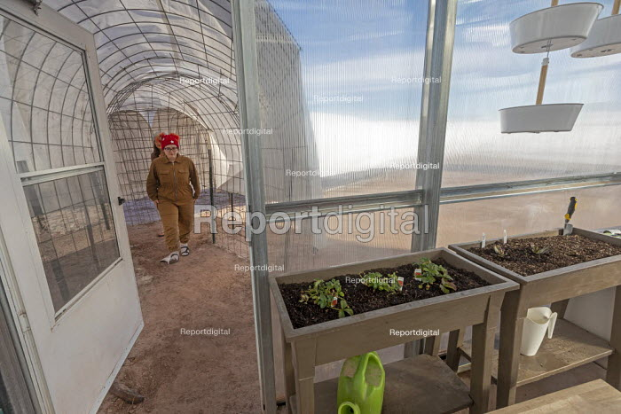 Hanksville, Utah, USA: Mars Desert Research Station. Researchers simulate living on Mars. 'Expedition Boomerang' brought Australian researchers to the station. Jennifer Lane walking through a connecting tunnel to the GreenHab where crop research is undertaken - Jim West - 2019-11-13