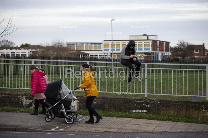 Pedestrians and Youth on his mobile phone, Hazel Leys, Corby, Northamptonshire - John Harris - 2019-12-07