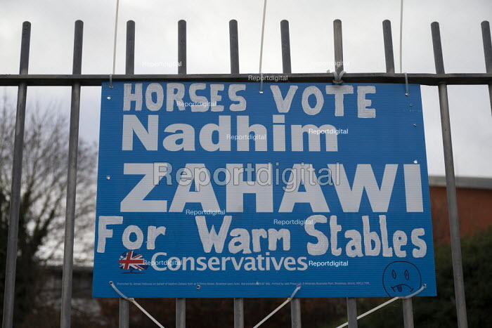 Horses Vote Nadhim Zahawi For Warm Stables, grafftti on a Conservatives general election poster referring to MPs expenses scandle when Millionaire Conservative MP Nadhim Zahawi claimed taxpayer's money for electricity to run his horse riding school stables business and a yard manager���s mobile home - John Harris - 2019-12-13