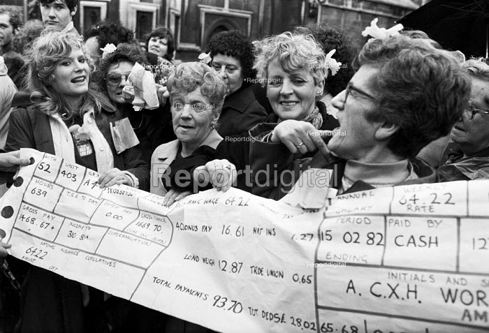 Health workers with an giant pay slip lobby Parliament for better pay, London 1982 - NLA - 1982-03-15