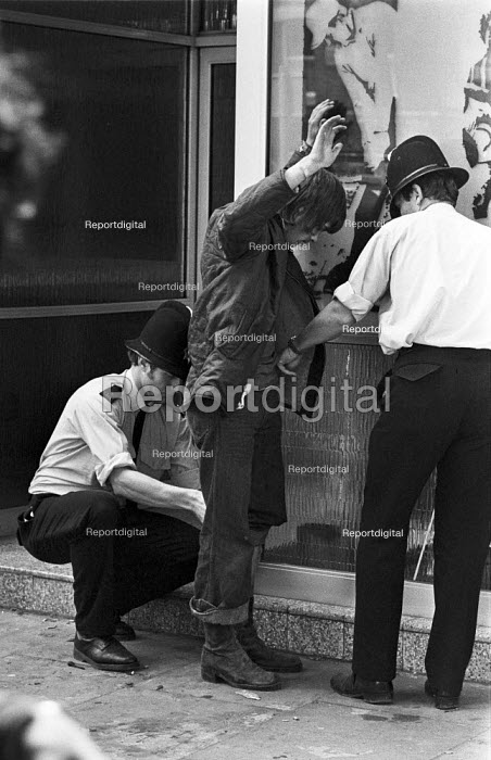 Police stop and search a youth for drugs, Reading Pop Festival 1977 - NLA - 1977-08-28