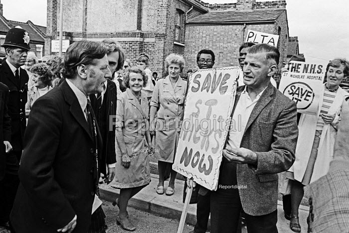 David Ennals MP passing angry protestors opposed to closure, St Nicholas Hospital, Greenwich, South London 1977 - NLA - 1977-09-26