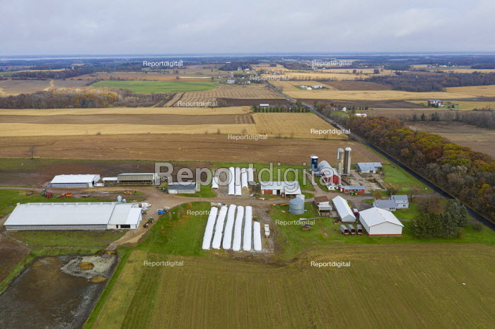 Omro, Wisconsin, USA, a dairy farm with automated milking machines. The long white plastic bags are used for gain and silage storage, a less expensive alternative to building a new silo. Knigge Farms - Jim West - 2017-09-14