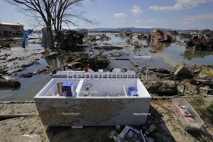 Refrigerator beached amoungst the devastation, Soma Port, Soma City Fukushima prefecture, Earthquake and Tsunami, Japan - Kobayashi Masanori - 2011-03-12