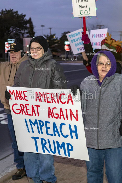 Rochester Hills, Michigan, USA Protest for the impeachment of President Trump. They were outside the office of Elissa Slotkin, a Democrat elected in 2018 to represent a district that voted for Trump in 2016. The rally was one of more than 500 pro-impeachment rallies scheduled in all 50 states - Jim West - 2019-12-17