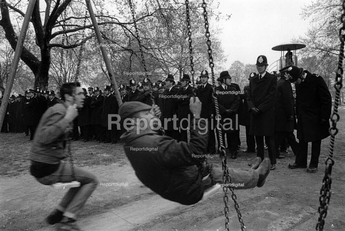 Miners on swings infront of police, Newham 7 Defence Campaign protest, Plashet Park, London, 1985 - Dave Sinclair - 1985-05-11