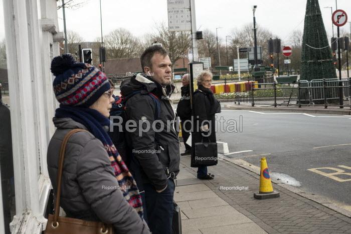 Passengers waiting at a bus stop, Stratford upon Avon, Warwickshire - John Harris - 2020-01-09