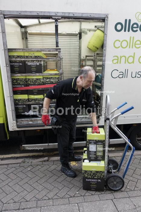 Driver delivering fresh rapeseed cooking oil and used oil collection, Olleco, Stratford upon Avon, Warwickshire. Used oil from restaurant & hotel kitchens is recycled as biofuel renewable energy - John Harris - 2020-01-09