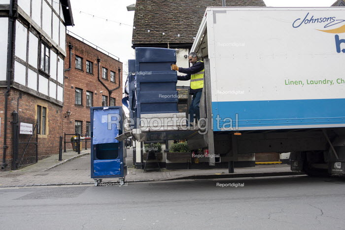 Driver collecting dirty hotel laundary, Stratford upon Avon, Warwickshire - John Harris - 2020-01-09
