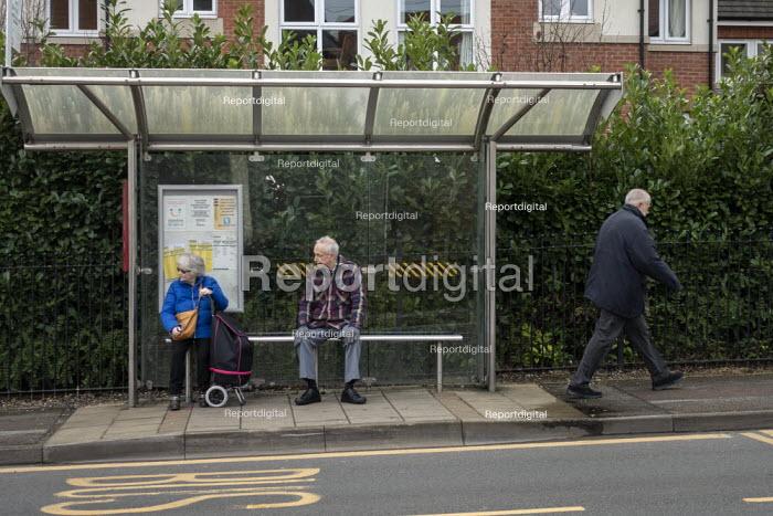 Elederly passengers waiting at a bus stop, Stratford upon Avon, Warwickshire - John Harris - 2020-01-09