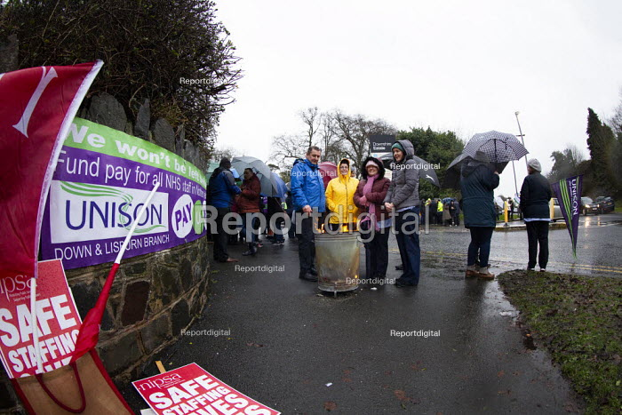 Northern Ireland Health Workers strike over safe staffing levels and pay parity, Downshire Hospital, Downpatrick. Attempting to Keep Warm in the rain - Conor Kinahan - 2019-12-18