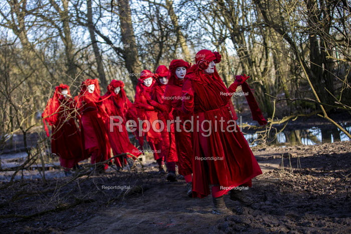 The Invisible Circus, Stop HS2 protest camp against the destruction of 108 ancient woodlands, Colne Valley, Uxbridge. Red Rebel Brigade performing - Jess Hurd - 2020-01-18