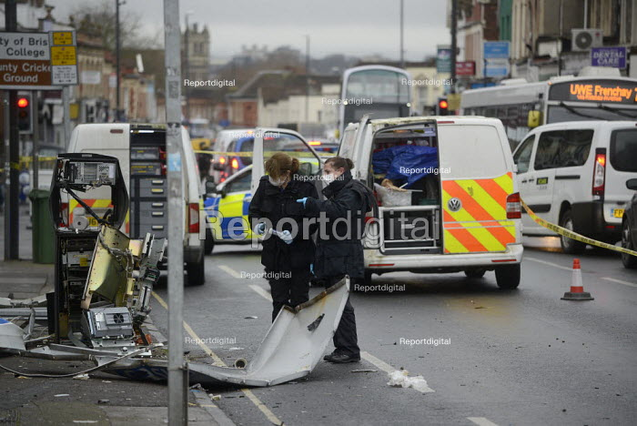 Gloucester Road, Bristol, Forensic scientist examinng a Cashpoint machine destroyed in an explosion - Sam Morgan Moore - 2020-01-30
