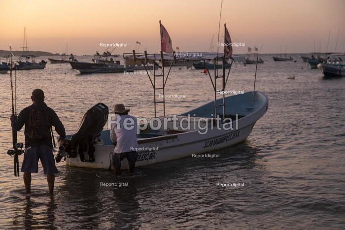 Puerto Escondido Beach, Oaxaca, Mexico - Fishermen preparing their fishing boat for a sport fishing trip. - Jim West - 2020-02-04