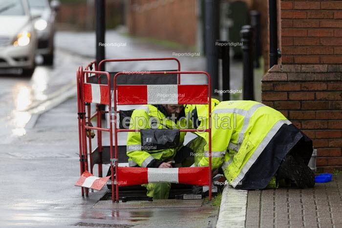 BT Openreach engineers at work at a manhole, Stratford upon Avon, Warwickshire - John Harris - 2020-02-24