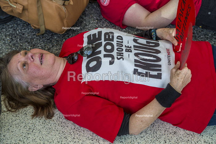 San Francisco International Airport, USA, UNITE HERE service workers protest low pay and the failure of employers to agree a fair contract. The workers, who prepare food for airlines, die-in, laying down inside the terminal and then blocked the roadway outside. One Job Should Be Enough - David Bacon - 2020-02-14