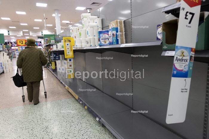 Toilet rolls disappearing off the shelves, Coronavirus panic buying as customers stockpile, Morrisons Supermarket, Stratford upon Avon, Warwickshire - John Harris - 2020-03-06