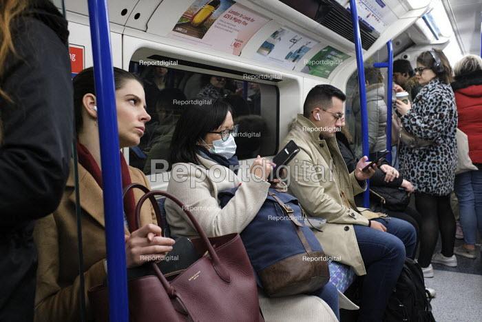 Passenger with face mask, London Underground - Duncan Phillips - 2020-03-06
