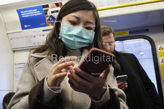 Passenger with face mask, London Underground - Duncan Phillips - 2020-03-10