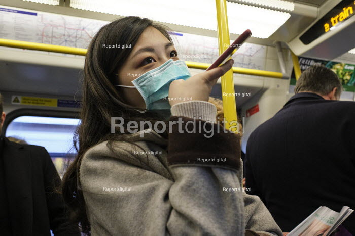 Passenger with face mask, London Underground - Duncan Phillips - 2020-03-10