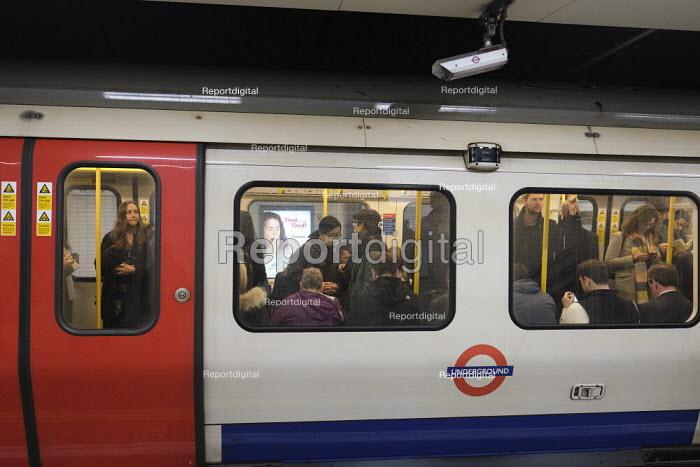 Passenger with face mask, London Underground - Duncan Phillips - 2020-03-11