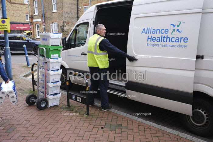 Alliance Healthcare delivery driver delivering pharmaceutical, surgical, medical, and healthcare products, London - Duncan Phillips - 2020-03-19