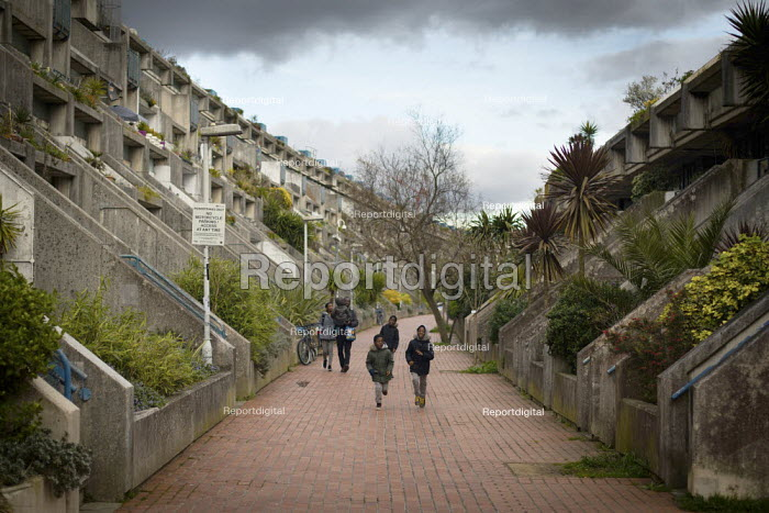 Famly with young children walking home, as schools are closed due to coronavirus, Alexandra Road Estate, Camden, London - Connor Matheson - 2020-03-20