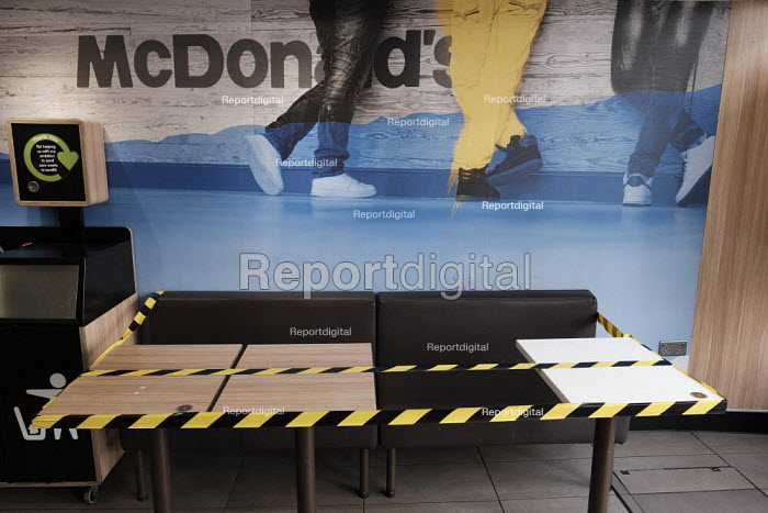McDonald's seating taped off seating areas to help customers to keep social distance, Richmond, London - Duncan Phillips - 2020-03-20