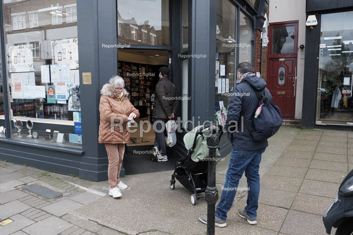 Chemist shop limiting customers to two at a time, social distancing for those waiting, Coronavirus, Richmond, London - Duncan Phillips - 2020-03-20