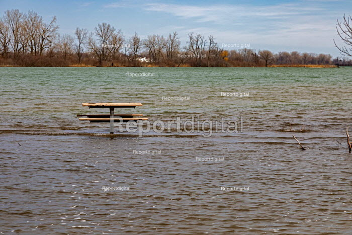 Detroit, Michigan USA. Picnic table far from land, Belle Isle state park. Record high water levels on Detroit River and the Great Lakes have led to shoreline erosion and flooding. - Jim West - 2020-03-22