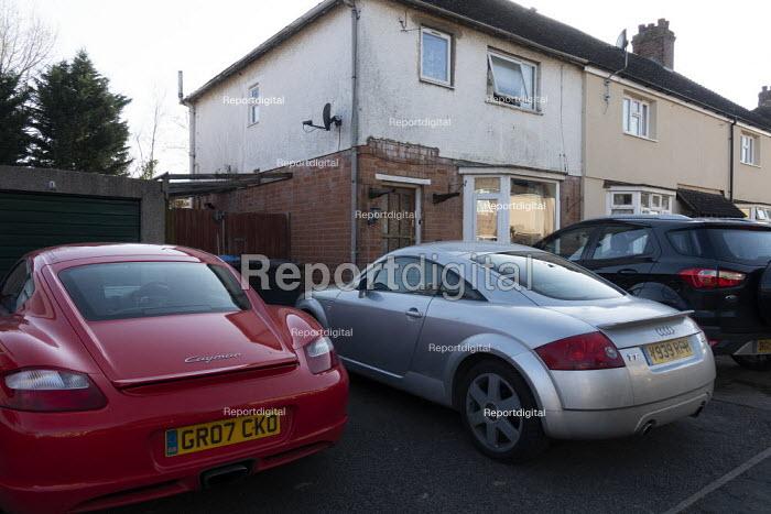 Sports cars infront of a dilapidated house, Stratford Upon Avon, Warwickshire. Red Porsche 718 Cayman, Audi TT Sport - John Harris - 2020-03-25