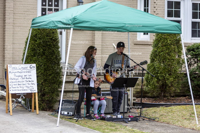Michigan USA Brother and sister playing a porch concert... - Jim West, JW2003249.jpg