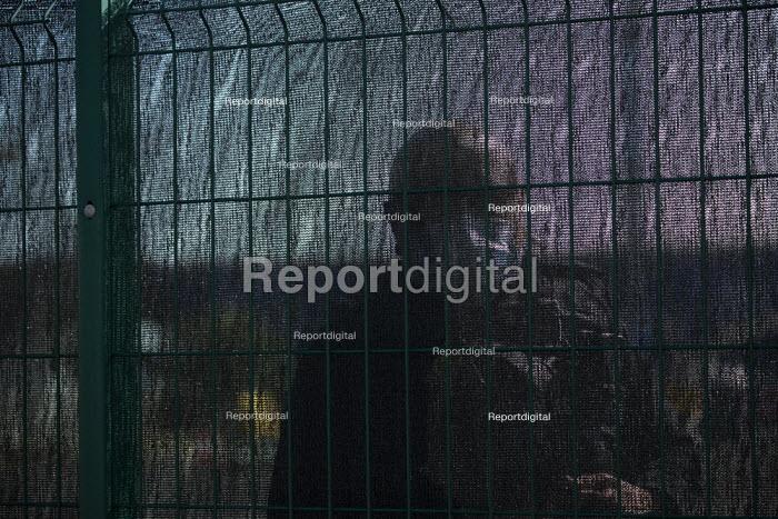 Coronavirus Pandemic. Police officer questioning journalist through a fence. Testing NHS workers for Covid-19, Drive thru Coronavirus test centre, Edgbaston Cricket Ground car park, Birmingham. - John Harris - 2020-04-07
