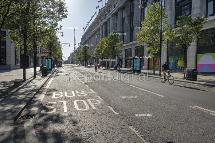 Coronavirus pandemic. Empty pavements, closed shops and no traffic, Oxford Street, London. - Philip Wolmuth - 2020-04-20