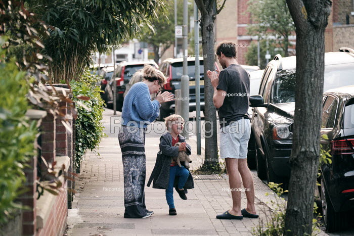 Coronavirus Pandemic. Parents and little boy. Clap for Our Carers applause for NHS and care workers, Putney, London - Duncan Phillips - 2020-04-23