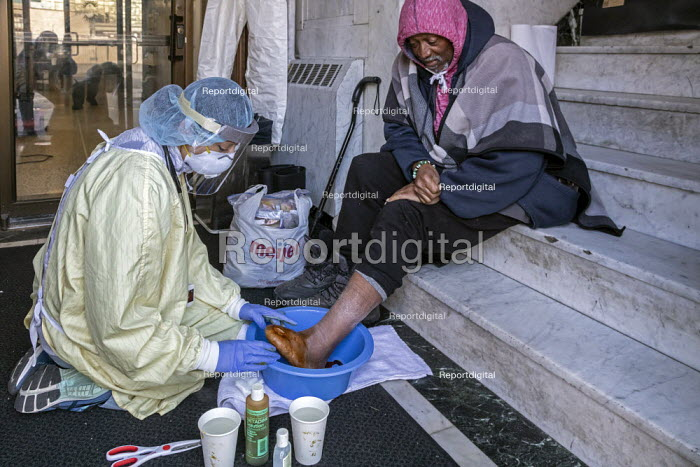 Detroit, Michigan USA. Coronavirus Pandemic. Homeless people getting medical help, Pope Francis Center. The Center has had to close its indoor spaces due to the coronavirus pandemic. Dr. Asha Shajahan of Beaumont Hospital examines Arthur Carter, 70, in a vestibule. Carter lost his toes to diabetes. - Jim West - 2020-05-01