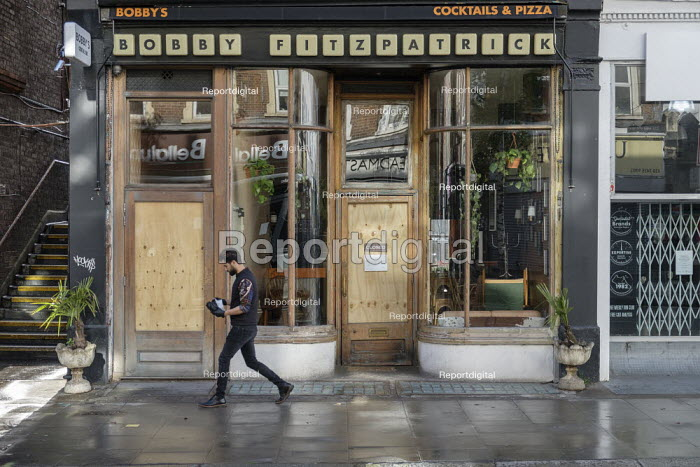 Covid-19 pandemic. Closed and boarded-up pizza bar, West Hampstead, London. - Philip Wolmuth - 2020-05-01