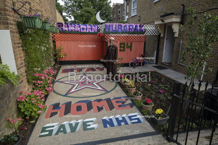 Coronavirus Pandemic. Haq with his tribute to the NHS, lockdown and Ramadan, Tower Hamlets, East London. Stay Home Save The NHS - Jess Hurd - 2020-05-21