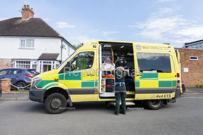 Coronavirus Pandemic: Paramedics putting on PPE, responding to emergency as an elderly man becomes ill with Covid-19, Stratford upon Avon - John Harris - 2020-05-07