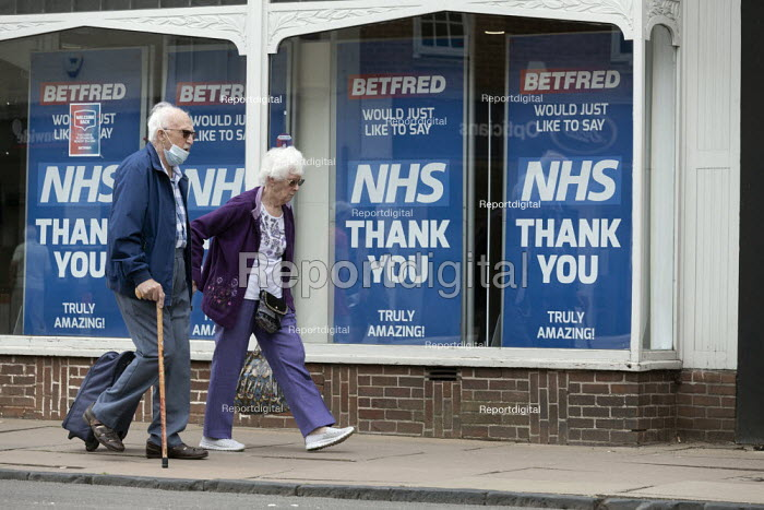 Elderly couple walking pas NHS Thank You signs, Stratford Upon Avon - John Harris - 2020-06-16