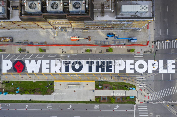 Detroit, Michigan USA POWER TO THE PEOPLE painted by youth on Woodward Avenue with the support of the city of Detroit. The project comes amid weeks of Black Lives Matter protests over the murder of George Floyd and police violence against other African Americans - Jim West - 2020-06-18