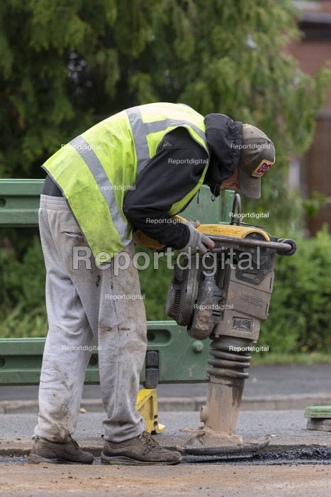 Workers tarmacing after installing a new gas main, using a two-stroke trench rammer without ear defenders, Stratford-upon Avon - John Harris - 2020-06-19