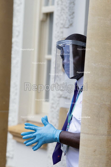 Marsk up Friday, Security guard with a face shield visor, checking visitors, District Council Offices - John Harris - 2020-07-24