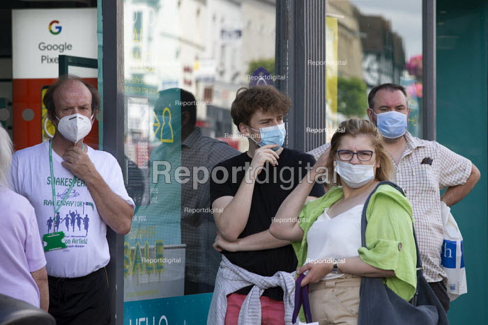 Mask up Friday, Shoppers queing to enter a phone shop, wearing masks in the street, Stratford Upon Avon - John Harris - 2020-07-24