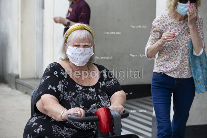 Mask up Friday, Shoppers wearing masks in the street, Stratford Upon Avon. Disable woman on a mobility scooter - John Harris - 2020-07-24