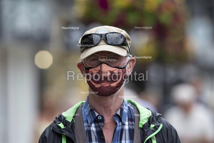 Mask up Friday, tourist wearing novelty mask in the street, Stratford Upon Avon - John Harris - 2020-07-24