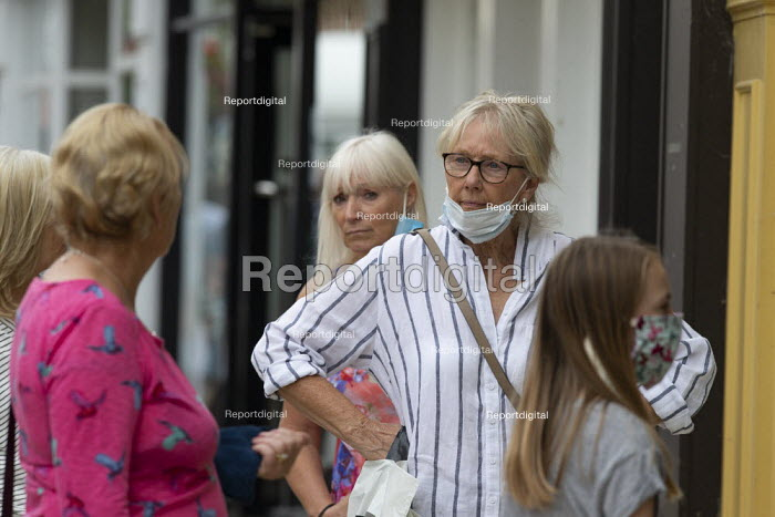 Mask up Friday, shoppers with masks talking as they wait in line in the street, Stratford Upon Avon - John Harris - 2020-07-24