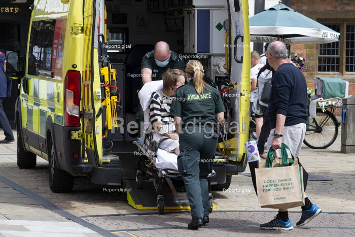 Paramedics loading a patient who has collapsed in the street into an ambulance Stratford Upon Avon - John Harris - 2020-07-29